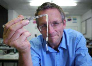 Michael Mosley holds up a human tapeworm