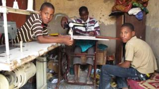 Children in a tailors shop in Timbuktu, Mali
