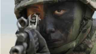 File photo: A South Korean marine takes position during the joint military exercises in 2013 as a part of annual Foal Eagle military exercises in South Korea