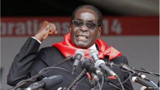 Zimbabwe's President Robert Mugabe addresses supporters during celebrations to mark his 90th birthday
