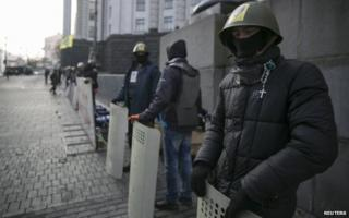 Activists guard a government building Kiev