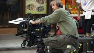 """US director and producer Michael Bay holds a camera during the filming of a scene for the movie """"Transformers: Age of Extinction"""" in Hong Kong, 24 October 2013"""