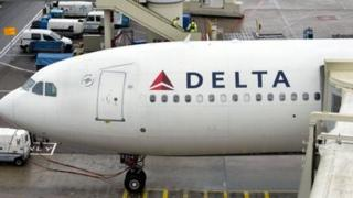 A Delta airplane at a gate in Amsterdam.