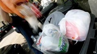 Waste being put in a bin