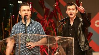 Matt Helders and Alex Turner of Arctic Monkeys at the NME Awards