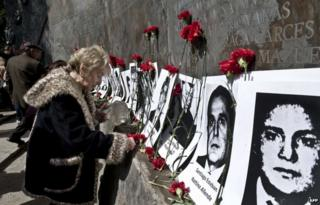 Flowers are laid in Santiago, Chile, in memory of victims of the Pinochet government, September 2013