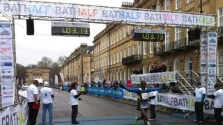 Winner Nicholas Kirui crosses the finish line in the 2014 Bath Half