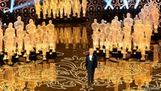 Ellen DeGeneres hosts the Oscars ceremony