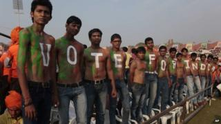 "Supporters of India""s opposition Bharatiya Janata Party (BJP)""s prime ministerial candidate Narendra Modi stand with their bodies painted at a youth convention in Ahmadabad, India."