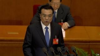 Chinese Premier Li Keqiang delivers a work report during the opening session of the annual National People's Congress in Beijing's Great Hall of the People, China, 5 March 2014