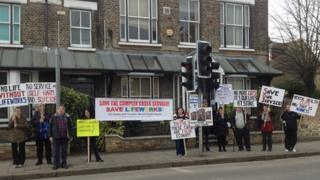 Protesters outside the Tenison Road Centre