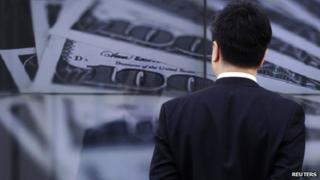 Man looking at money