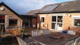 The converted shed and greenhouse