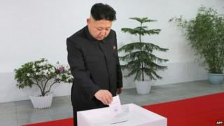 This photo dated 9 March 2014 and released by North Korea's official Korean Central News Agency (KCNA) on 10 March shows North Korean leader Kim Jong-un casting his ballot in the election of a deputy to the Supreme People's Assembly Kim Il-sung University of Politics