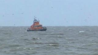 Lifeboat searching for people in the sea off Lowestoft