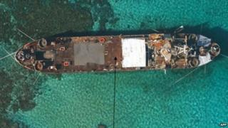 Undated handout photo released by the Philippine Government in 2013 shows an aerial view of BRP Sierra Madre grounded at Second Thomas Shoal in the Spratly islands