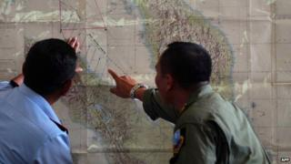 Officials plan military search operation for the missing plane (12 March 2014)