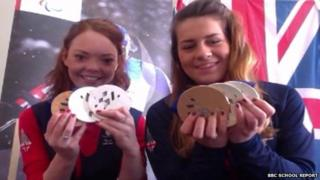 Jade Etherington (left) and Caroline Powell holding their Paralympic medals
