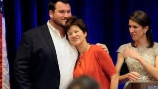 Democrat Alex Sink rests her head on her son's chest after conceding defeat in her congressional race on 11 March, 2014.