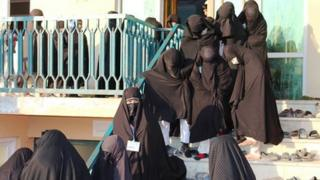 Female students in full body veil at the Ashraf-ul Madares madrassa