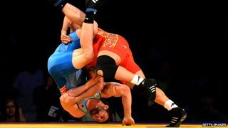 Athletes from the Iran and US team during a match in the Freestyle Wrestling World Cup in Los Angeles