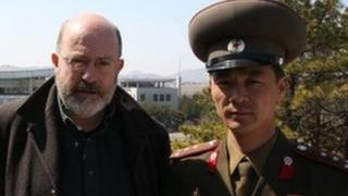Panorama reporter John Sweeney alongside North Korean official