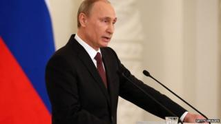 Russian President Vladimir Putin speaks at the Kremlin on 18 March, 2014.