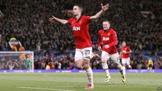 Robin van Persie celebrates after scoring a goal