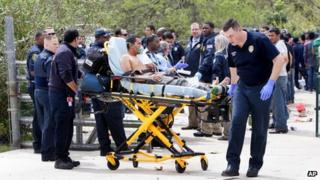 A person is taken from a Houston, Texas, house on a gurney on 19 March 2014