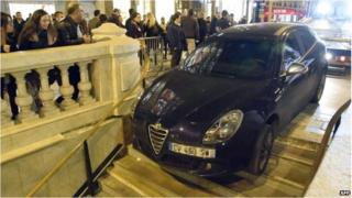 Car stuck on the steps of a Paris metro station
