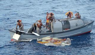 Members of the Brazilian Frigate Constituicao recovering debris in June 2009