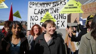 Caroline Lucas with fracking protesters outside court