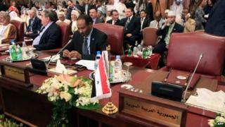 Empty seat for Syrian representative at Arab League summit in Kuwait (25 March 2014)