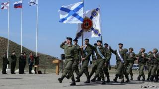 Russian marines march at a military base in Sevastopol, Crimea, on 24 March 2014