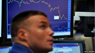 Man looks a stock exchange graph