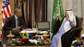 Barack Obama (L) meets Saudi King Abdullah (R) at Rawdat Khurayim, the monarch's desert camp, on March 28