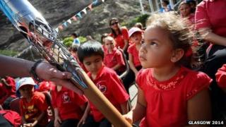 Primary school pupil with the Queen's baton in St Helena