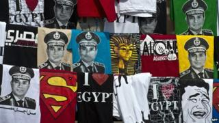 T-shirts bearing the image of ex-Field Marshal Abdul Fattah al-Sisi on sale in Cairo's Tahrir Square in October 2013