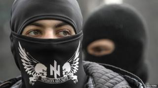 Members of Right Sector stand outside the parliament in Kiev - 28 March 2014