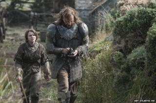 Arya Stark (Maisie Williams) and Sandor Clegane (Rory McCann)