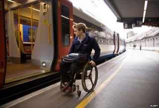 Man in wheelchair at Waterloo station - image for illustration purposes
