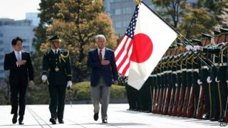 US Secretary of Defence Chuck Hagel (right) reviews honour guards accompanied by Japanese Defence Minister Itsunori Onodera