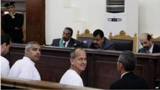 Baher Mohamed (left), Mohamed Adel Fahmy (second left), and Peter Greste