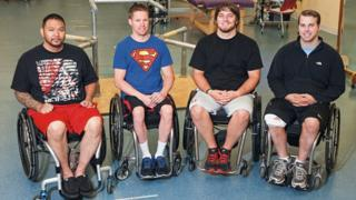 Four men in wheelchairs