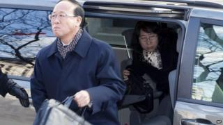 Slain York University student Qian Liu's father Liu Jianhui and mother Zheng Yaru, right, arrive at court in Toronto 24 March 2014