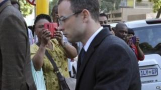 Oscar Pistorius arriving in court on 8 April 2014