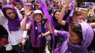 Supporters of the birth control law celebrate outside the Philippine supreme court