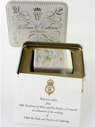 Slice of royal wedding cake in its presentation tin with a note from Prince Charles and the Duchess of Cornwall