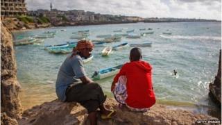 Somali fishermen look at the Mogadishu harbour