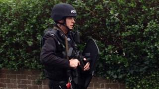 Policeman with riot shield